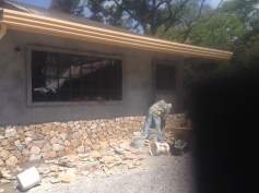 The front of the house is getting stonework
