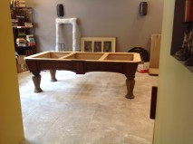 the pool table is not ready to use quite yet, but its at least in its new home!