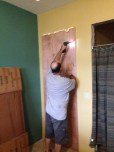 Scott is taking down the temporary door into our new master bathroom that is just finally usable, not finished yet, but sorta usable