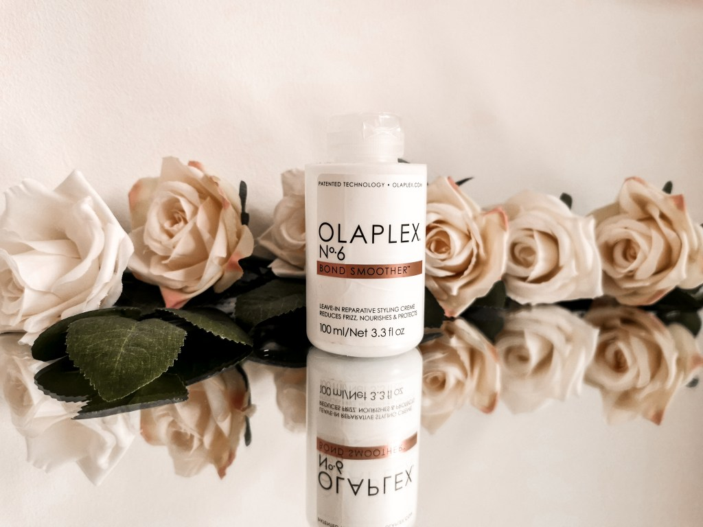 Bottle of Olaplex No.6 surrounded by flowers