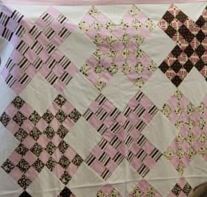 Pauline will be working on this sweet baby quilt.  Small borders on the top and bottom, no border on the sides.