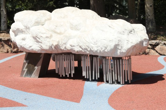 This is a cloud bench in a playground with wind chimes to catch the lower breezes