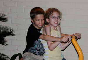 Jenni's oldest grandchild is an amazing inspiration to us all.  Here she and her younger brother play together.