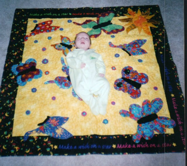 You were so tiny and frail - I had not made you a quilt yet and I felt to guilty - Mimi helped pick out the fabrics and I raced home after visiting you in the hospital and made your quilt.  It has accompanied you to many hospital visits.  It is well worn and very much loved!