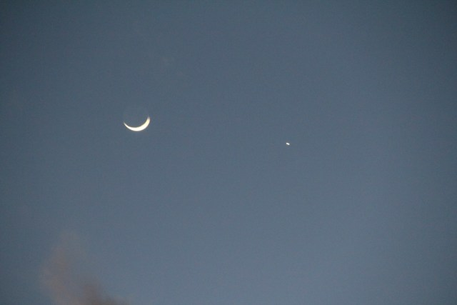 A sliver moon and is that Venus?  I know nothing of astronomy!  Sorry folks!