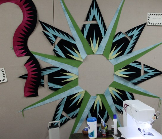 """Ardelle's Mariner's Compass is gorgeous - she and Roger each of the new Kaufman """"silks"""" as accents in their quilts - talk about accentuate the positive!"""