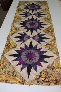 Carolyn attended my workshop with the Bay Area Quilters Guild in June.  She brought her finished top in to share.  (She also worked on her Captains Wheel from class!)