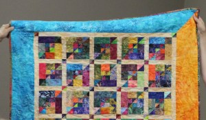 """Show and tell - this piecer was """"gifted"""" more than a few tiny triangles from Nancy - she brought this beautiful quilt to show the guild and Nancy what she made with those tiny triangles"""