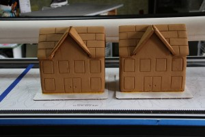 Pre-decorating.  Side-note:  The icing did not dry like glue this year, so hubby used epoxy to build the houses.  We build before the children arrive because the icing/glue needs to set before decorating.