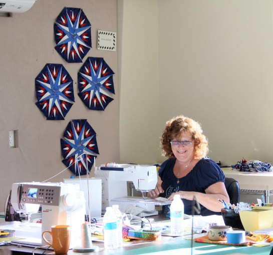 Ginny is also a certified instructor and will be a certified ship, her colorful Mariner's Compass was the inspiration for my own!  Ginny is working on her Captains Wheel quilt - I love the red, white and blue!  Very appropriate to honor her Marine son!