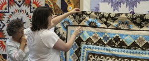 Kim shows us to create squares of quilting above the ohio stars in the blue/cream fabrics.  I like it!