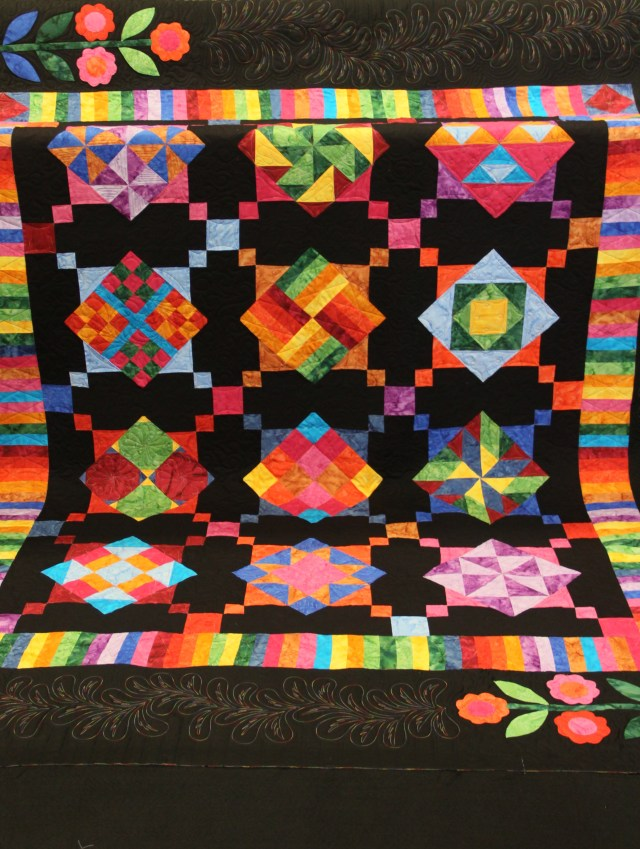 Full view of the quilt - lovely batiks!