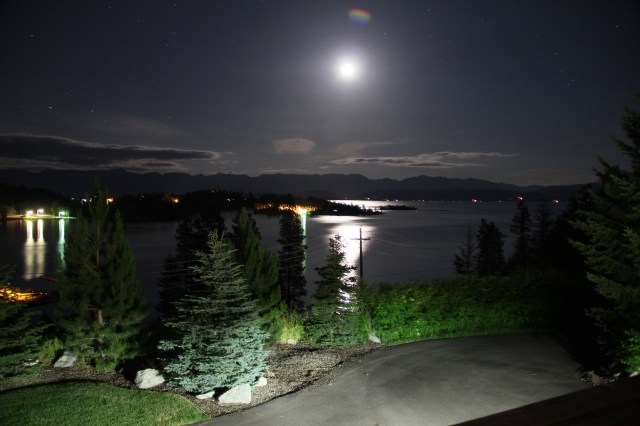 "It was probably close to 3 am when we were heading to bed.  Peggy said ""look at that moon!""  I of course had to grab my camera - then I had to grab Connie.  We used her tripod and expertise but luckily we were using my camera so I have the photo!  You can see the stars and reflections in the lake - Thanks Connie!"