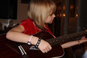 Getting the feel!  Always encourage children to make and enjoy music - think what your life would be without music!