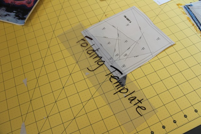 "Now place your folding template (template plastic 3"" by 12"") on SOLID line 1  as shown in photo"