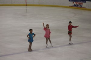 The warm up before competition for basic 2 skaters....