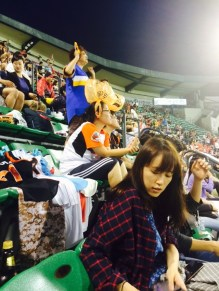 Doosan Bears fans with plastic bags tied to their heads. Because obviously.