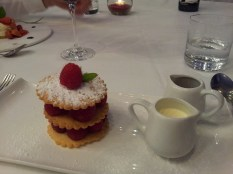 Home-made shortbread biscuits with fresh raspberries and cream, at Caravaggio, London