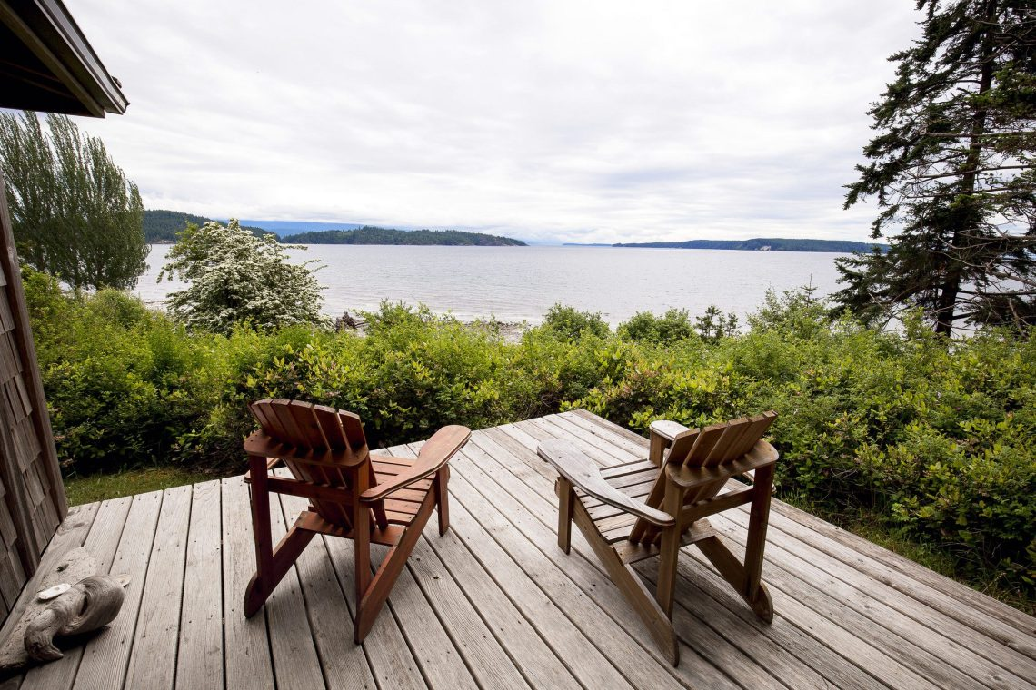 Two Chairs on a Deck Overlooking the Ocean at a Retreat Centre