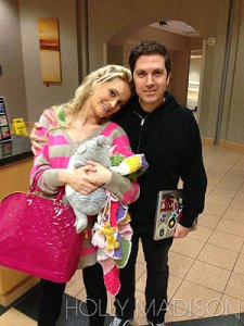 Holly madison Leaving the hospital