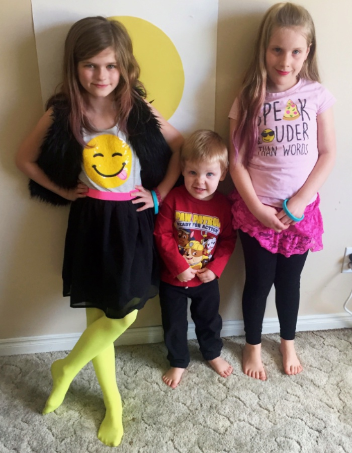 Hollys Awesome Emoji Dress Is From The Childrens Place Her Bright Yellow Tights Were A WinnersFabFind For Only 2 Brookes T Shirt Was Also Found