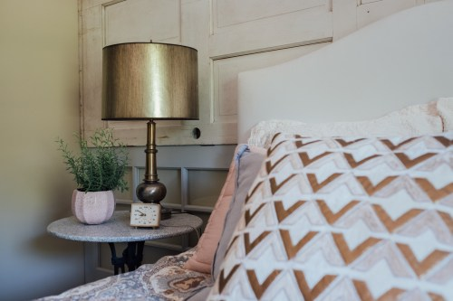 brass midcentury lamp plus gold and pink pillows