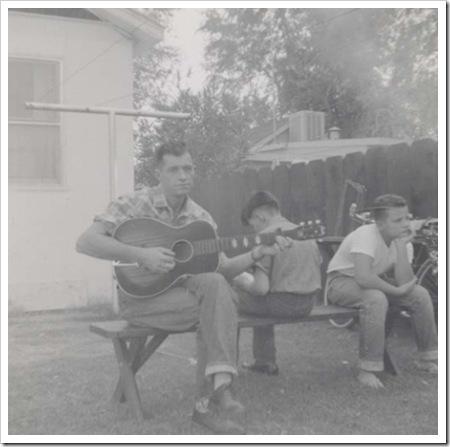 neville_playing_guitar