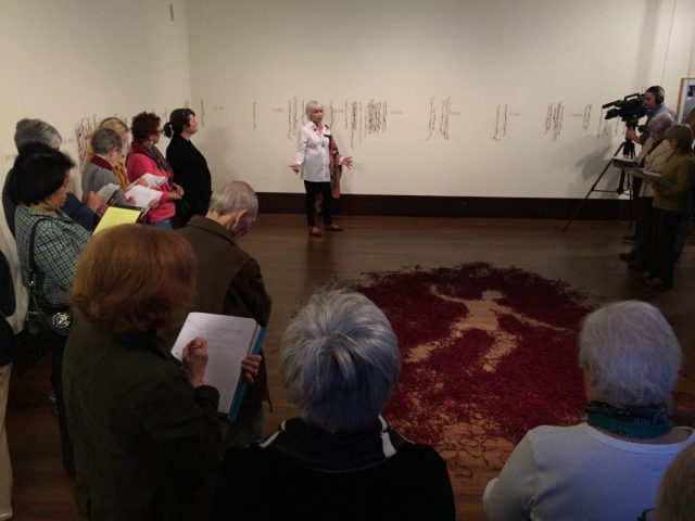 """Luzene Hill is explaining her piece """"Retracing the Trace"""". At the Exhibition Conversations: Eiteljorg Museum 2015 Contemporary Art Fellowship."""