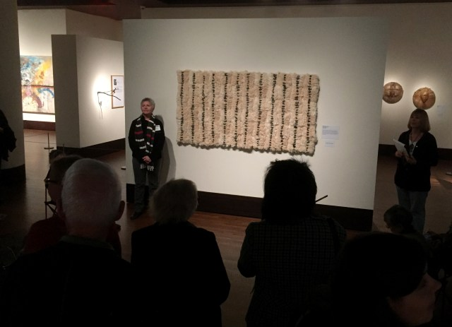 """Brenda Mallory is explaining her piece """"Reformed Spools"""". At the Exhibition Conversations: Eiteljorg Museum 2015 Contemporary Art Fellowship."""