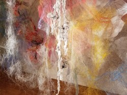 """""""Mind/Forest I"""" (Detail 2) 2018, Polyester tulle, produce netting, thread, duralene plastic, plastic rope, and cotton gauze, 13'L x 18'W x 9'H."""