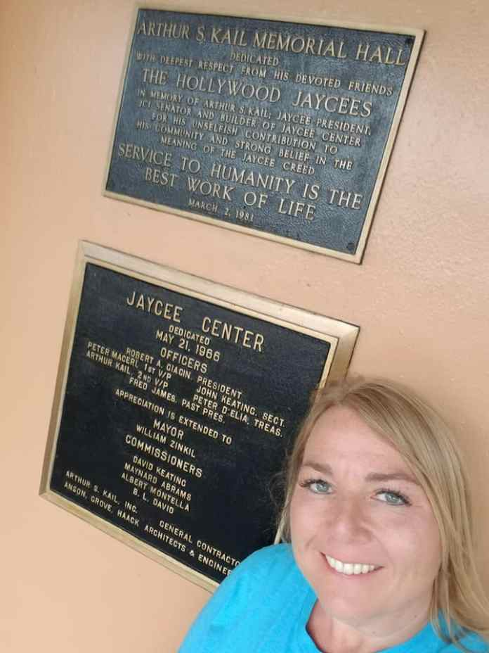 JCUSA President Tricia Buehne in front of the JCI Hollywood HQ -- Note some of the names on those plaques!