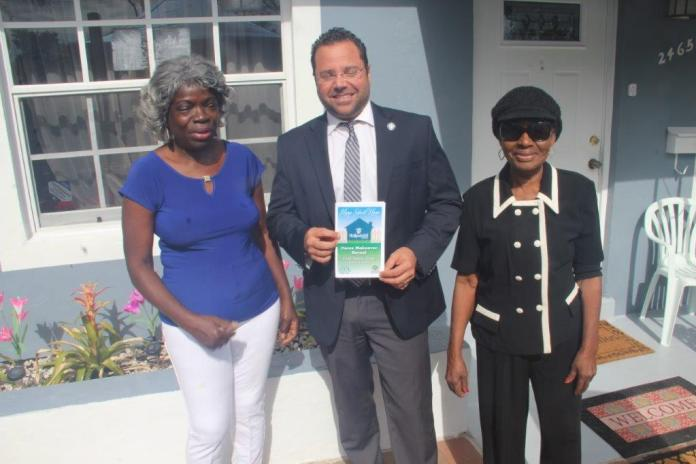 Juliet McGriff and Hollywood Mayor Josh Levy at the dedication of McGriff's renovated home.