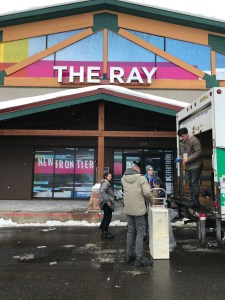 Volunteers brave the elements outside the Ray Theatre as they unload a delivery truck on January 23, 2019, in Park City, Utah, the day before the opening of the 2019 Sundance Film Festival. (Photo credit: Larry Gleeson/HollywoodGlee)