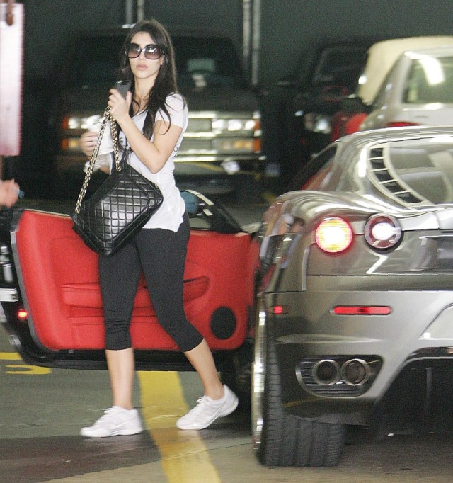Kim Kardashian West with her new Ferrari Kim Kardashian out and about in Los Angeles, America - 27 Mar 2009