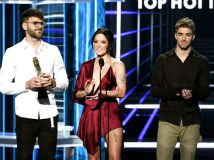 LAS VEGAS, NV - MAY 20: (L-R) Recording artists Alex Pall of The Chainsmokers, Halsey, and Andrew Taggart of The Chainsmokers speak onstage during the 2018 Billboard Music Awards at MGM Grand Garden Arena on May 20, 2018 in Las Vegas, Nevada. (Photo by Kevin Winter/Getty Images)