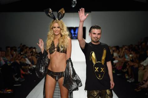Standing ovation...Erik Rosete of Mister Triple X with one of his models from the show