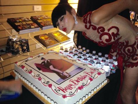 Actress Bai Ling blows a kiss to her birthday cake with her image on it