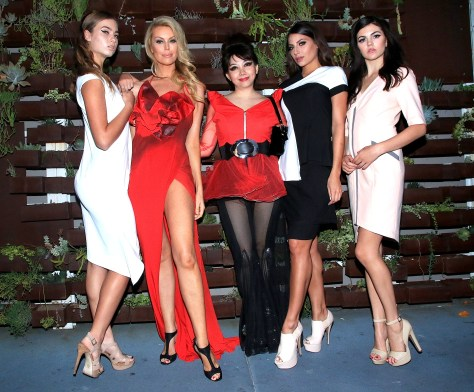 Quynh (center) and her models all decked out in her designs including actress Jessica McClain