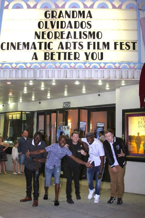 """The cast of """"Breathe"""" under the festival's marquee at the Lammle Theatre"""