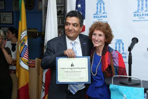 Janet Turner, representative of Congressman Ted Lieu, presents Farahanipour with a commendation
