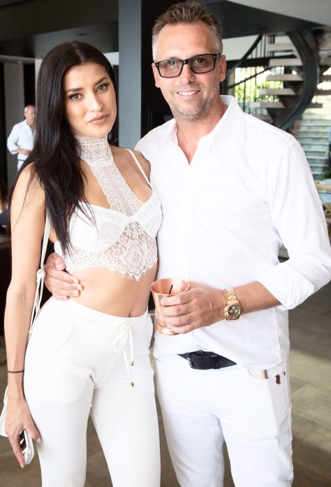 Nicole Williams (L) and Steve Shaw attend the Treats! Magazine 4th Annual White Party Sponsored By Stella Artois on September 17, 2016 in Malibu, California. (Photo by Gabriel Olsen/WireImage)