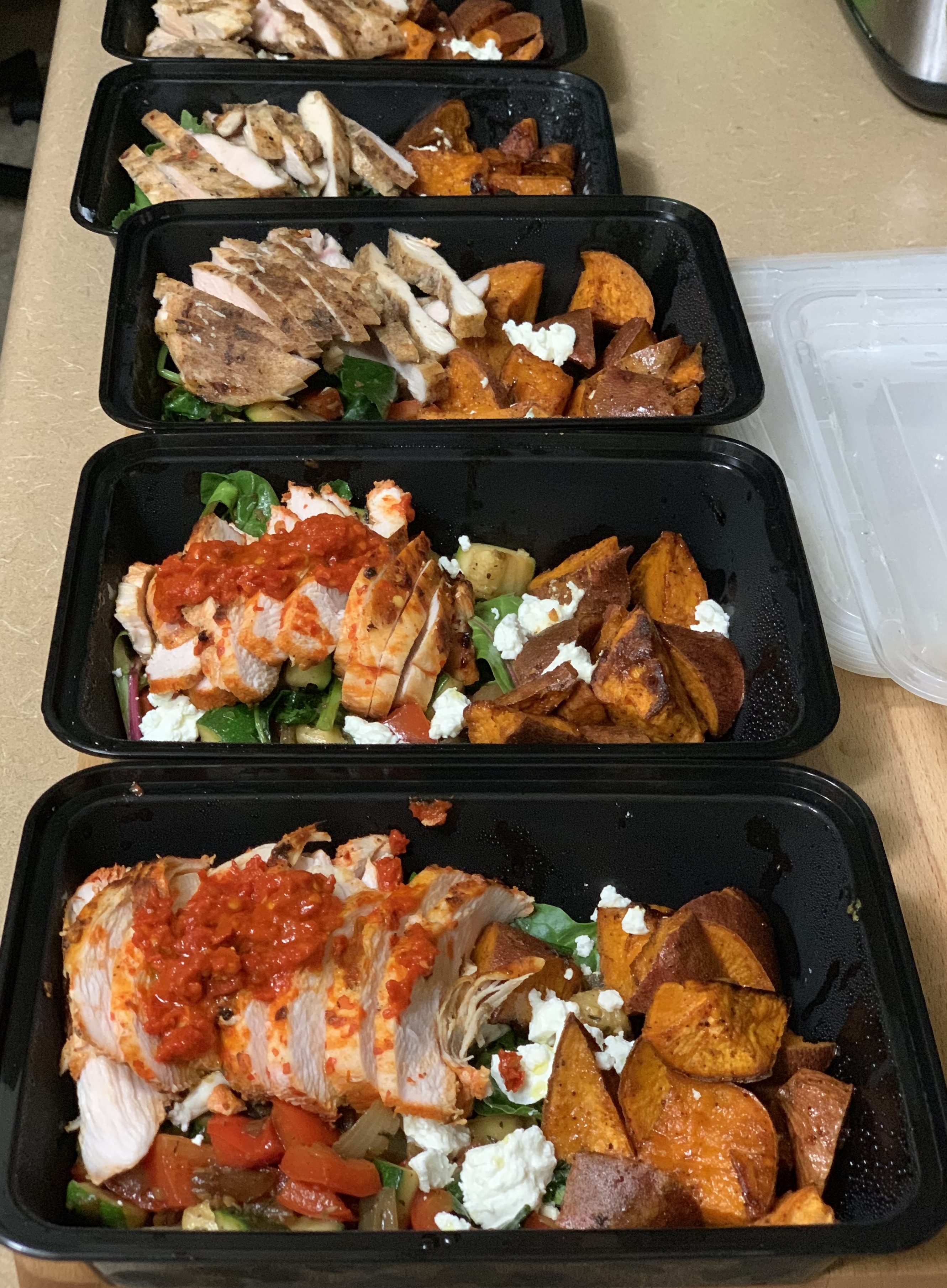 Grilled Harissa Chicken and Grilled Umami seasoned Chicken with vegetable hash and sweet/spicy roasted sweet potatoes, Chicken Taco Lettuce Wraps and Caprese Salad (Ingredients from Trader Joe's)