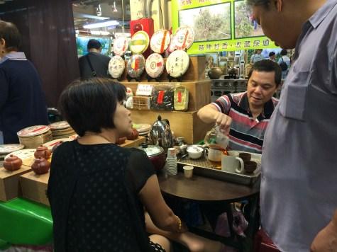 A Taipei tea vendor and his customers