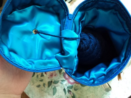 unzip and put your yarn skein or ball in and thread through the hole