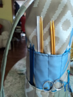 2 rows of pockets around the base hold double pointed knitting/crochet needles, scissors & holders.