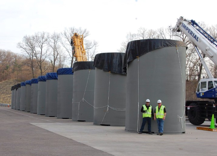 Gary Frye and Christopher Glembocki of Holtec in front of the 12 HI-STORM Overpacks at the DC Cook Nuclear Plant