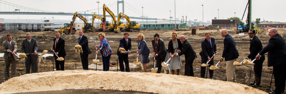 Groundbreaking Participants from left to right: Mr. Kevin Castagnola (Executive Director & CEO of SJ Port Corp.); Richard Alaimo (Chairman of SJ Port Corp.); Mr. Pierre Oneid (Senior V.P. and Chief Nuclear Officer of Holtec); Mr. William Levis (President & Chief Operating Officer of PSEG); NJ State Senator Nilsa Cruz-Perez; U.S. Congressman Donald Norcross; NJ Lt. Governor Kim Guadagno; Dr. Kris Singh (President & Chief Executive Officer of Holtec); Camden Mayor Dana Redd; Mr. Frank Moran (City of Camden Council President); Mr. Louis Cappelli (Camden County Freeholder Director); Mr. Joseph Jingoli (CEO of Joseph Jingoli & Son); Mr. PK Chaudhary (Holtec Senior V.P. of Operations); Mr. Allen Hickman (Holtec V.P. of Manufacturing and Supply)