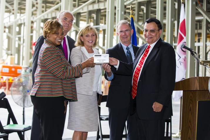 Topping-off Ceremony Keynote Speakers Together Raise a Miniature Version of a Steel Girder From Left to Right: Camden Mayor Dana Redd; Commissioner Bob Martin (NJ Department of Environmental Protection); NJ Lt. Governor Kim Guadagno; Mr. William Levis (President and COO of PSEG); Dr. Kris Singh (President and CEO of Holtec)