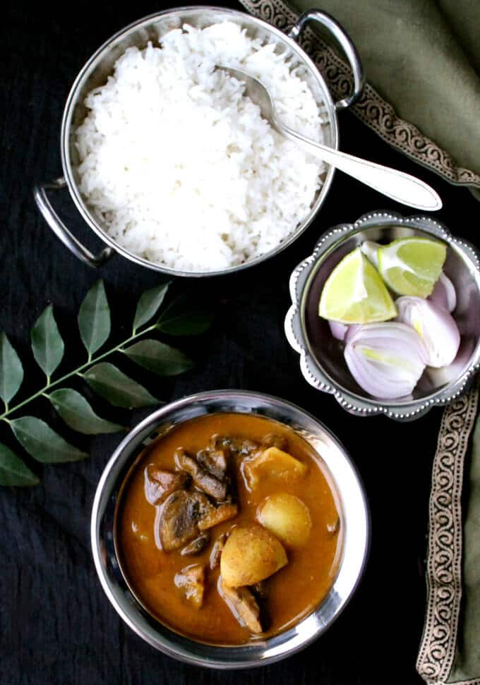 This Railway Mushroom Curry is so full of flavor, you'll find yourself making it over and over. A vegan, soy-free, nut-free and gluten-free recipe. #vegan #food #indianfood #vegetarian #recipe #healthyfood #dinner HolyCowVegan.net