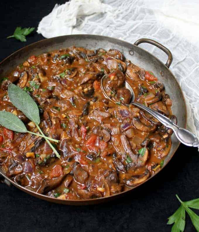 A recipe for vegan Mushroom Stew that's ready in 30 minutes. Savory, flavorful, meaty and piping hot, a bowl of this easy stew is exactly the kind of food I crave on a cool Fall day. This recipe is delicious, needs just one pot, and it takes under 30 minutes to make. Serve it over pasta or with a crusty bread. Vegan, gluten-free and nut-free. #vegan #glutenfree #nutfree #mushroom - HolyCowVegan.net